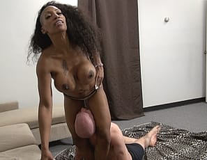 Tattooed female bodybuilder Coco Crush, in panties, humiliates a man who hasn't done his job, wrestling him using her vascular biceps, ripped abs and powerful pecs, and scissoring him with her muscular ebony legs and glutes until he's really sorry.