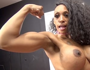 In panties, ebony female bodybuilder and tattooed fem domme Coco Crush poses, gets muscle worship, and verbally humiliates her kitchen bitch, scissoring him with her muscular legs in their high-heeled shoes and using her glutes, ripped abs, vascular biceps and pecs to wrestle him into submission, while you watch in close-up.