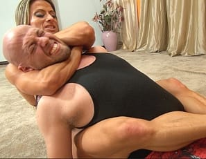 Sexy Maria G finds herself in front of another hapless male. How is the powerful female bodybuilder going to handle this? Well lets just say that she is going to workout her big biceps, powerful pecs, delicious abs and glorious glutes by crushing and scissoring Dante into oblivion! Maria G is powerful. She knows it, we know it, and now Dante knows it!