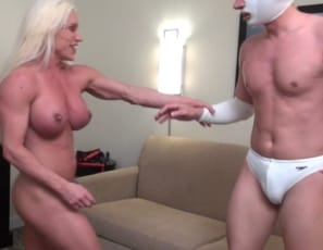 A wrestler comes to female bodybuilder and muscle porn star Ashlee Chambers for training. What he gets is verbal humiliation, smothering, scissoring, and a faceful of Ashlee's strong glutes in her panties. Her vascular biceps and muscular pecs, abs and legs ensure that she wins the wrestling match.