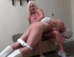 Female bodybuilder and muscle porn star Ashlee Chambers is humiliating a man who wants to wrestle, scissoring him with her muscular legs and glutes, holding him down with her vascular, biceps, ripped abs and powerful pecs, and posing to show him who's boss.