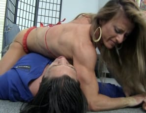 When tattooed professional female bodybuilder Maria G shows up for a wrestling match, her male opponent says she'll never win. But once she uses her powerful pecs, vascular biceps, ripped abs and muscular legs and glutes to scissor him, with some help from her high-heeled shoes, he realizes he was wrong.